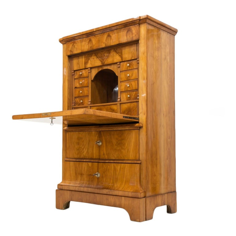 This beautiful Secretaire comes from Germany from the beginning of 19th century. The piece is made of coniferous wood, veneered with cherrywood veneer. The surface has been cleaned and refinished with shellac polish, applied manually which apart