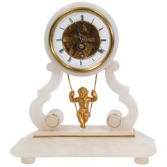 Cherub on a Swing Antique French Clock by Eugene Farcot