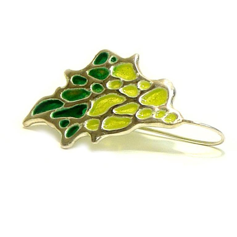 Our beautifully crafted sterling silver Sea Fan Earrings are given a stained glass effect with enamel. Inspired by the structure of coral, the negative space is covered with vibrant green glass.