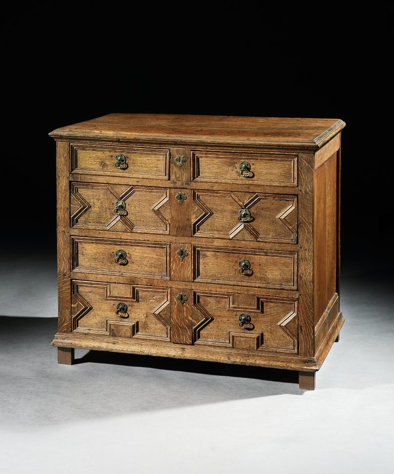 This chest of drawers has a lovely mellow color and patina. The carpenter has selected oak with fine medullary rays so that the figuring which is particularly evident on the top, down the sides and the middle of the front has become a charming