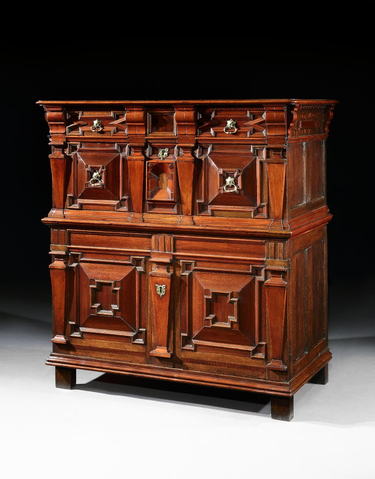 A museum quality, English, Late-Renaissance, cedar enclosed chest of drawers with exceptional snakewood, walnut & oak with an architectural or façade front  This is the most sophisticated English model of chest of drawers conceived as a cabinet