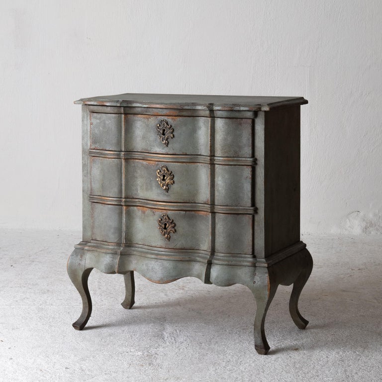 Chest of drawers Swedish Rococo 1750-1775 Greenish Blue, Sweden. A smaller chest of drawers perfect as a nightstand or side table made during the Rococo period in Denmark. Painted in a greenish blue with stunning patina. Original brass hardware.