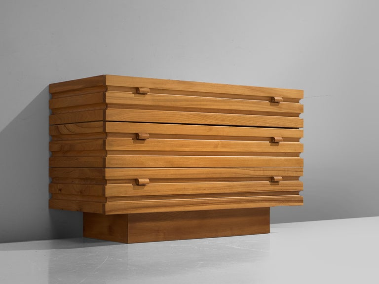 Maison Regain, sideboard, elm, France, 1970s  One brutalist cabinet with three drawers. This simplistic designed sideboard has an exceptional graphical structure on the front and sides of horizontal lines. The craftsmanship is truly visible in