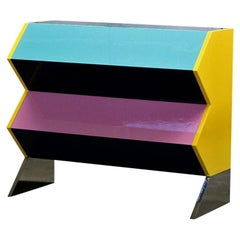 Chest of Drawers in Lacquered MDF with a Polish Stainless Base