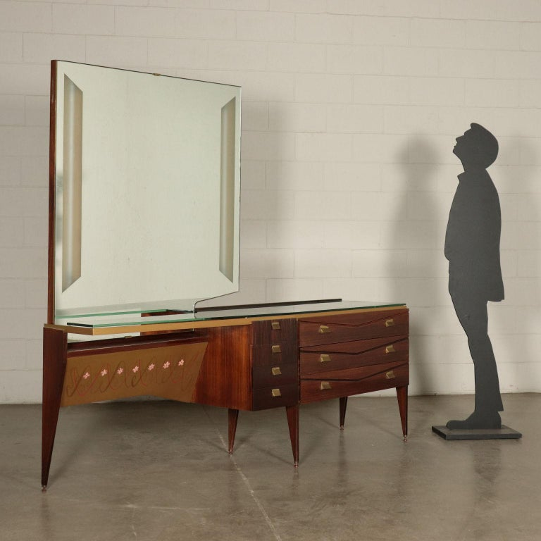 Chest of drawers with toilet area, veneered wood, knurled panels, clear glass top, backlit mirror, brass details.