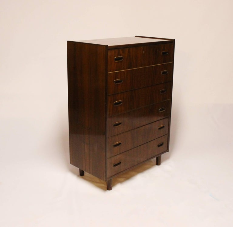 Chest with six drawers in walnut of Danish design from the 1960s. The chest is in great vintage condition.