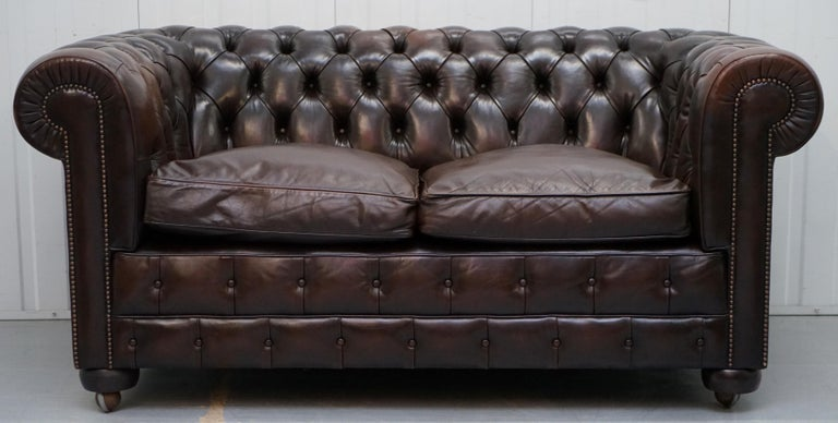 English Chesterfield Brown Leather Two-Seat Sofa Coil Sprung Feather Filled Cushions  For Sale