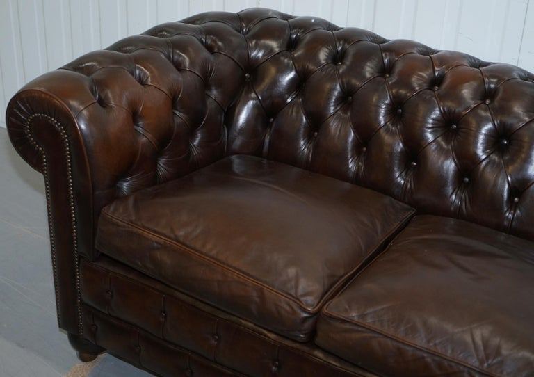 Chesterfield Brown Leather Two-Seat Sofa Coil Sprung Feather Filled Cushions  In Good Condition For Sale In London, GB
