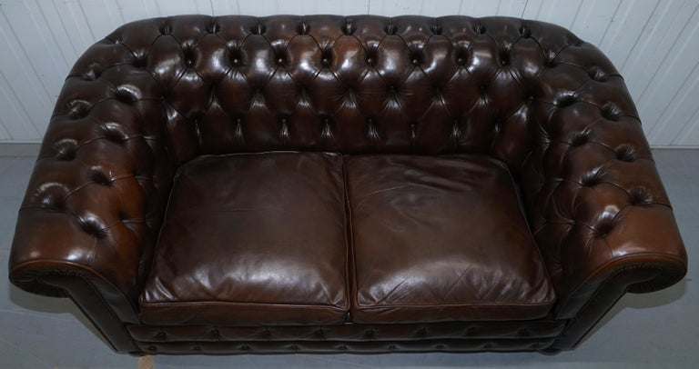 20th Century Chesterfield Brown Leather Two-Seat Sofa Coil Sprung Feather Filled Cushions  For Sale