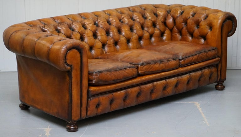 We are delighted to offer for sale this very rare fully restored Vintage hand dyed Whiskey brown leather Chesterfield sofa with original padding, coil sprung all-over and feather filled cushions   This sofa is a very rare model, its fully sprung