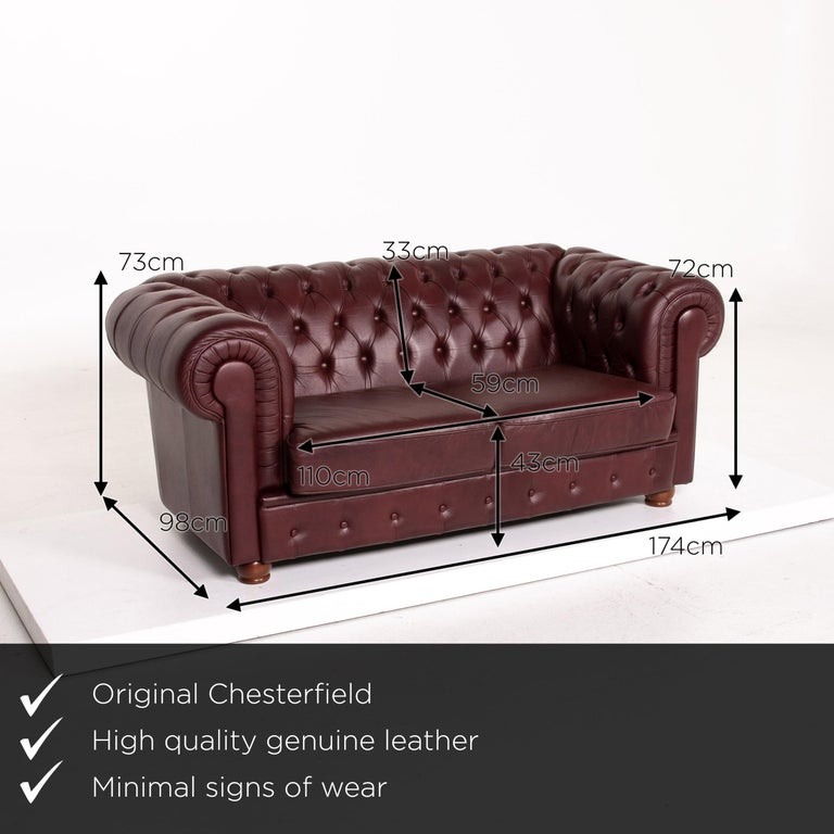 We present to you a Chesterfield leather sofa Bordeaux red two-seat vintage retro couch.