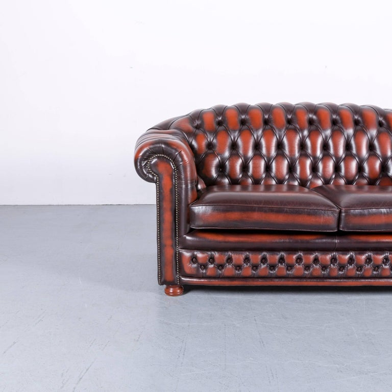 We bring to you an Chesterfield leather sofa brown orange two-seat.