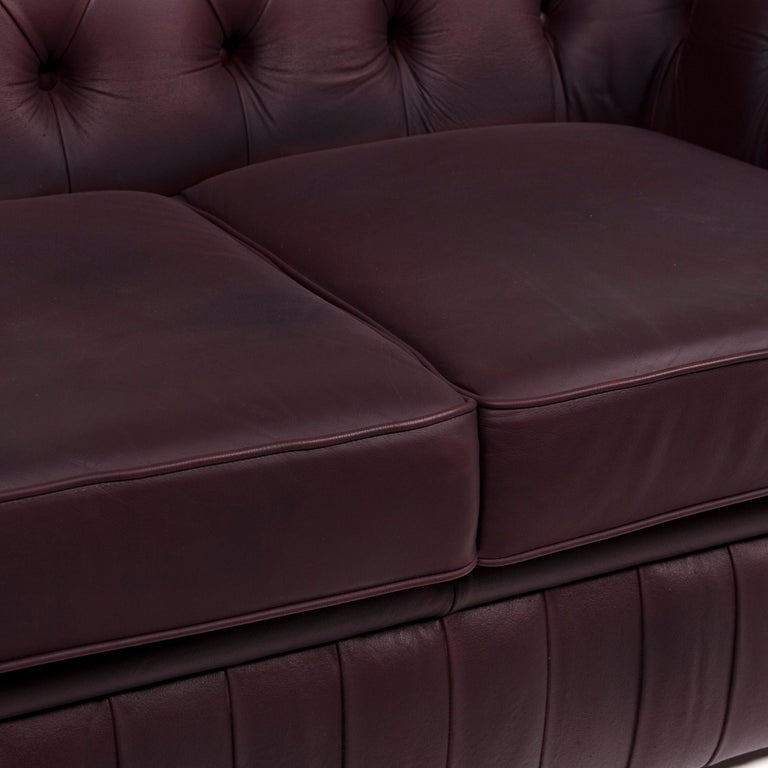 We bring to you a Chesterfield leather sofa brown purple two-seat retro couch.      Product measurements in centimeters:    Depth 95 Width 158 Height 84 Seat-height 43 Rest-height 65 Seat-depth 55 Seat-width 95 Back-height 41.
