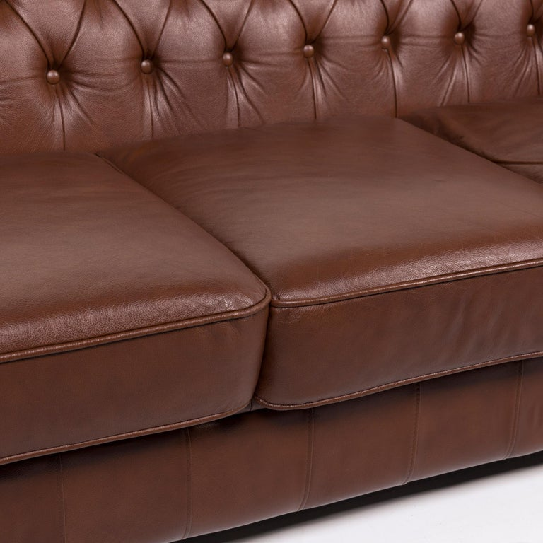 We bring to you a Chesterfield leather sofa brown three-seat.       Product measurements in centimeters:    Depth 94 Width 170 Height 73 Seat-height 44 Rest-height 72 Seat-depth 57 Seat-width 136 Back-height 31.