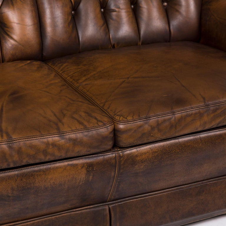 We bring to you a Chesterfield leather sofa brown two-seat.