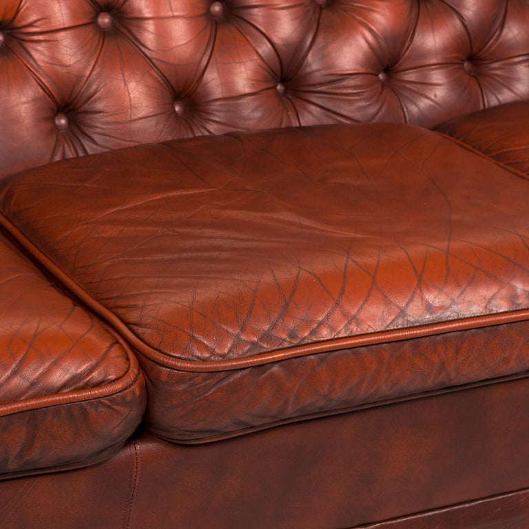 We bring to you a Chesterfield leather sofa red three-seat retro vintage couch.    Product measurements in centimeters:    Depth 89 Width 158 Height 74 Seat-height 41 Rest-height 61 Seat-depth 53 Seat-width 157 Back-height 36.