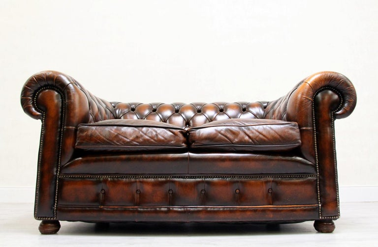 Chesterfield real leather two-seat sofa extra large in original design. Condition: The