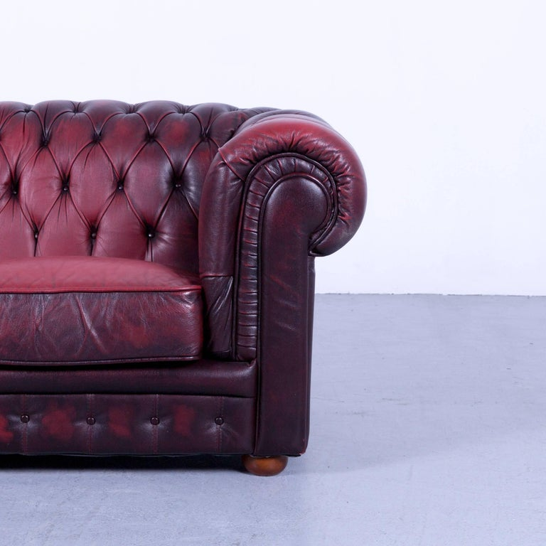 Chesterfield Two-Seat Sofa Red Leather Couch Vintage Retro Rivets In Good Condition For Sale In Cologne, DE
