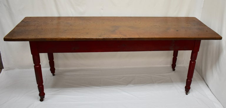 """This handsome farmhouse table has a 1.25"""" thick top fashioned from two wide chestnut boards, bearing all the scars of decades of purposeful use, without being too gnarled or scratched, and polished to a beautiful patina. There is an generous and"""