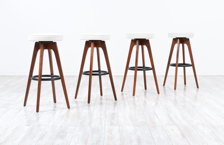 Chet Beardsley sculpted walnut swiveling stools for living design.