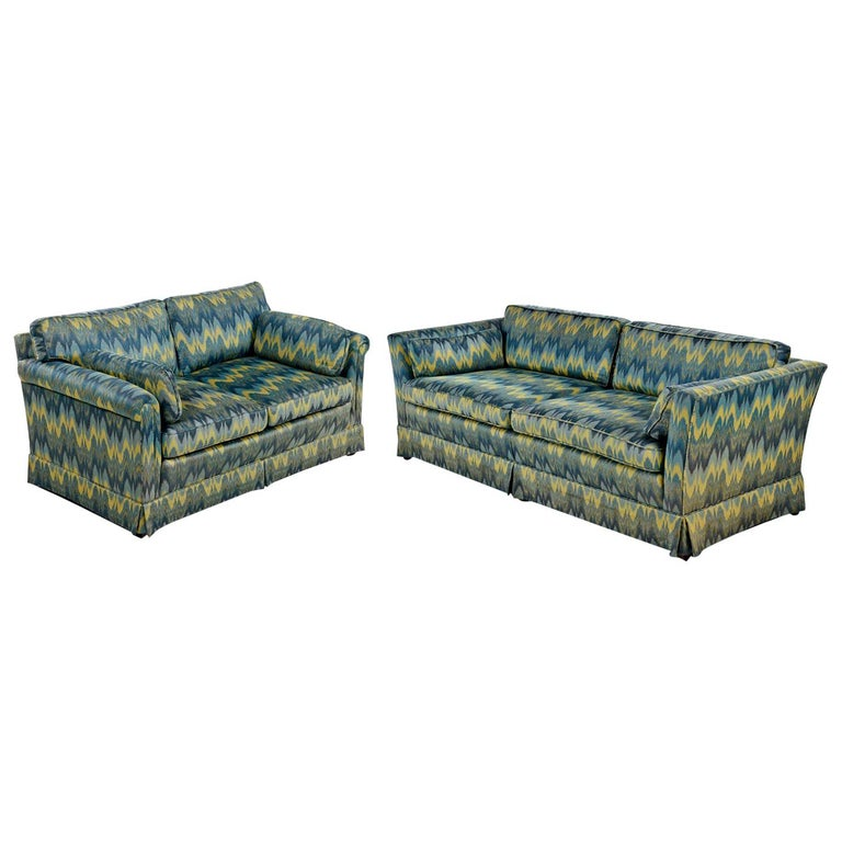 Although both sofas are by Baker and upholstered in the same fabric, they are slightly dissimilar. This electrifying chevron fabric looks like an EKG reading full of blues, greens and yellow variations. Bold an brilliant zigzag pulsing of cool