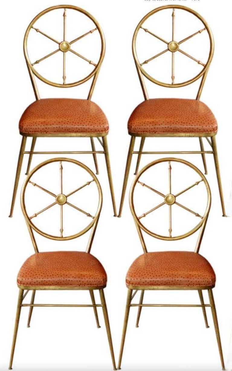 Set of four 1950s Italian brass Chiavari chairs with circular medallion backs inset with six point nautical ships compass motif in the style of Gio Ponti and Tomaso Buzzi. Seat cushions recently covered in textured faux ostrich. 36