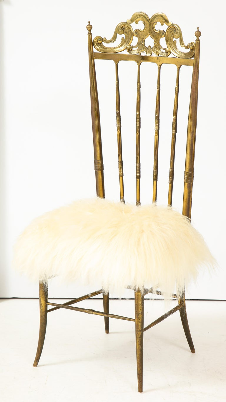 Italian midcentury Classic chair by Chiavari with great aged brass frame and new long haired sheepskin seat.