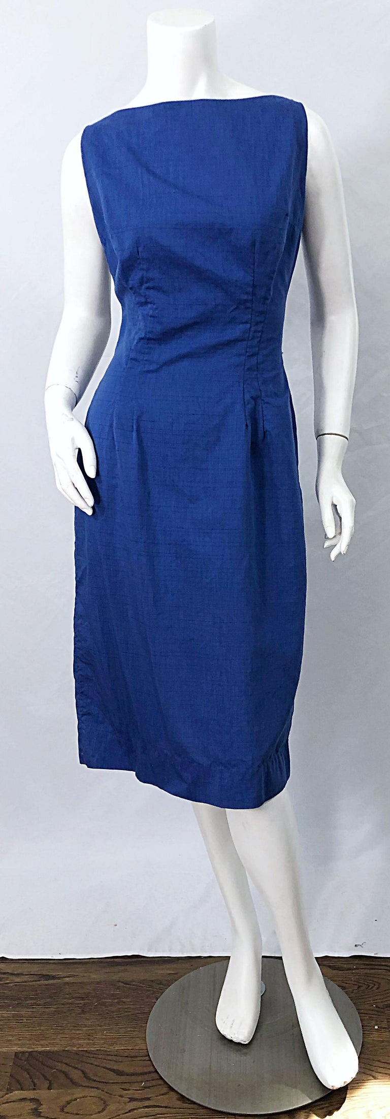 Chic late 1950s cobalt blue cotton sleeveless wiggle dress ! The perfect blue color that looks fabulous on any skin tone. Lightweight soft cotton. Full metal zipper up th eback with hook-and-eye closure. Very good quality with heavy attention to