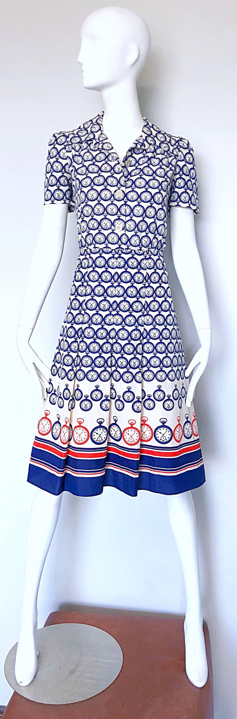 Chic vintage 1950s silk novelty pocket watch print silk fit n' flare nautical shirt dress! Features pocket watches printed throughout in red, white and navy blue. Buttons up the front with hidden zipper up the side. The possibilities are endless
