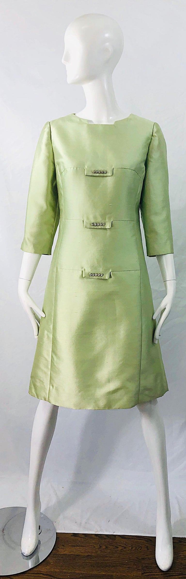 Chic 1960s mint green raw silk shantung rhinestone encrusted A-Line dress ! Features a architectural neckline. Tailored bodice with a forgiving A-Line skirt. Hidden zipper up the back with hook-and-eye closure. Fully lined. Perfect for any day or