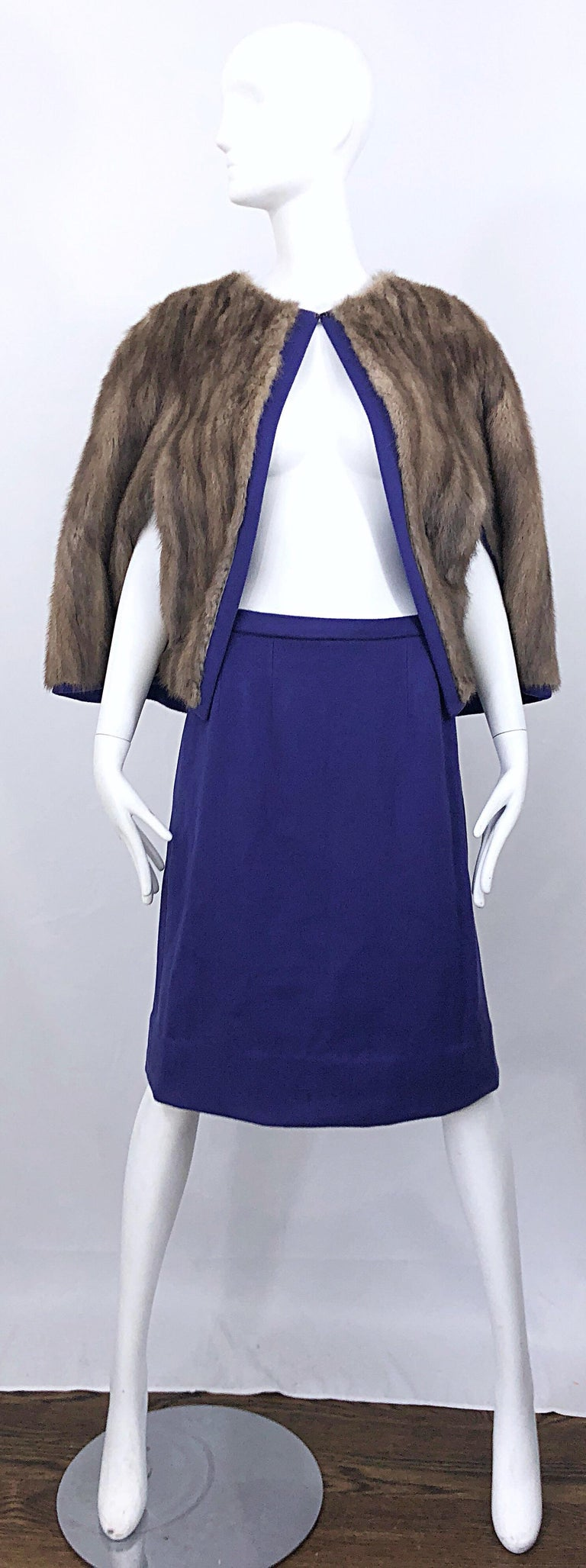 Chic 60s reversible sable fur and purple wool cape and A-Line skirt suit! Cape jacket features the softest, most luxurious sable fur that is a light brown, with a tinge of grey. Hook-and-eye closure at top neck. Brand new hidden zipper up the side