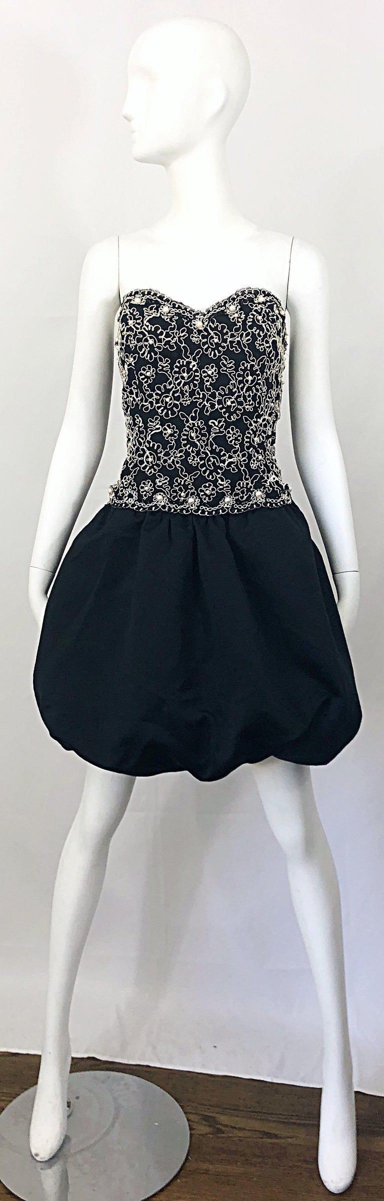 Chic vintage 80s black and white pearl encrusted Size 12 strapless embroidered party pouf dress! Features a fitted boned black bodice with white embroidery and hand-sewn pearls throughout. Forgiving pouf bubble skirt hides any 'problem' areas.