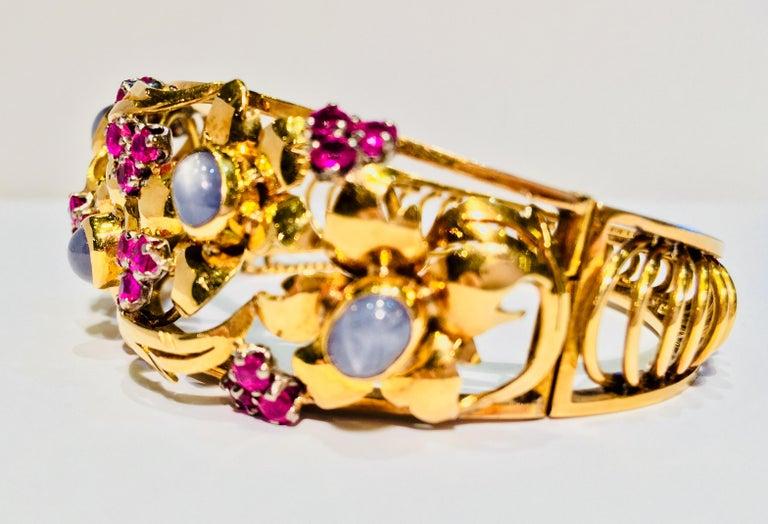 Oval Cut Art Nouveau Star Sapphire Natural Ruby 18 Karat Gold Floral Bangle Bracelet For Sale