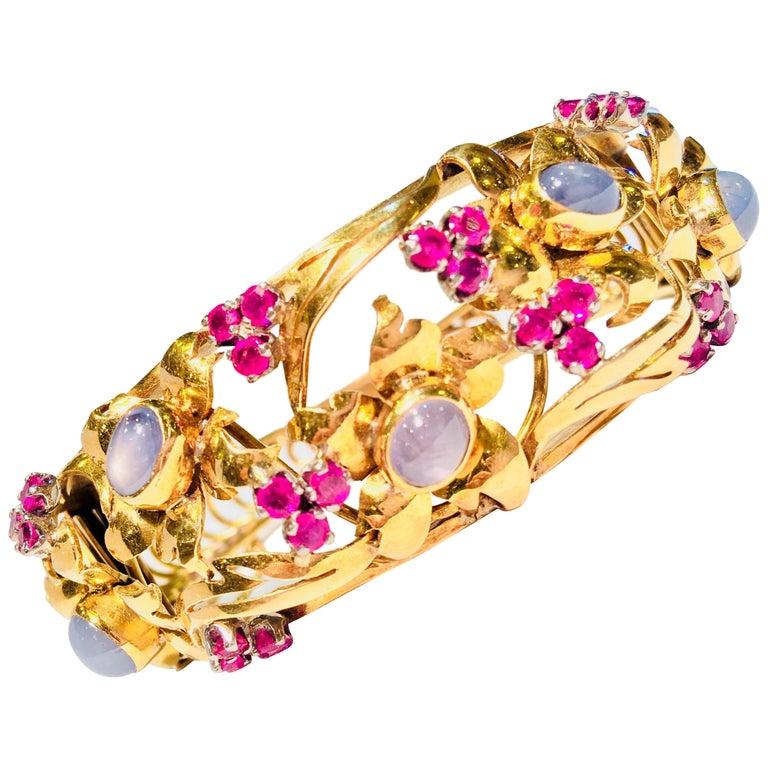 Art Nouveau Star Sapphire Natural Ruby 18 Karat Gold Floral Bangle Bracelet For Sale