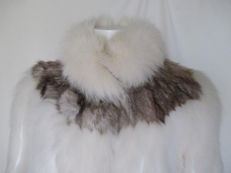 This vintage jacket is made of fox fur with leather panels, made by Saga (Saga furs, superior fur products)  We offer more luxury fur items, view our frontstore.  Details: With 2 pockets, 1 inside pocket, 3 closing hooks, 1 hook at the collar and