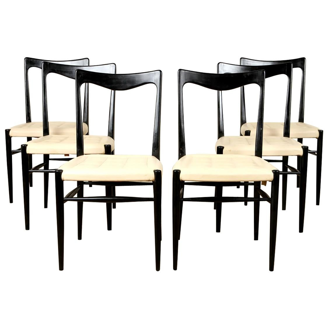 Chic Set of 6 Modern Ebonized Dining Chairs Having an Ivory Stitched Seat