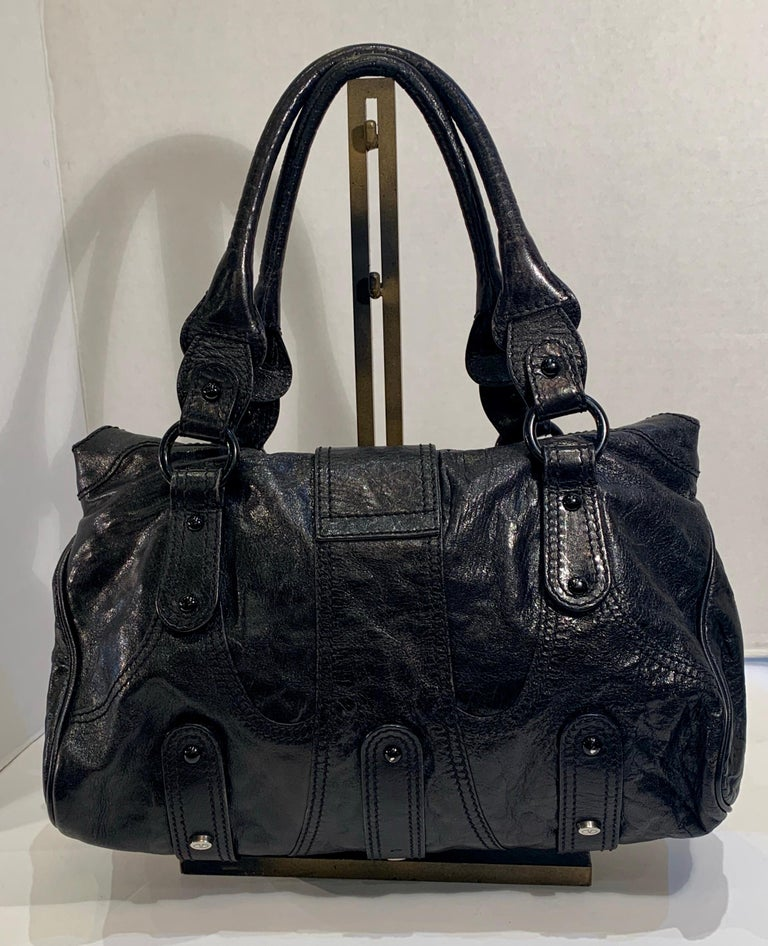 Soft and roomy leather unstructured purse from Valentino Garavani features a large, black crystal encrusted, iconic
