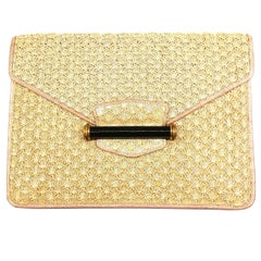 Chic woven straw, leather, bakelite and silk clutch bag, Alfred Dunhill, 1930s