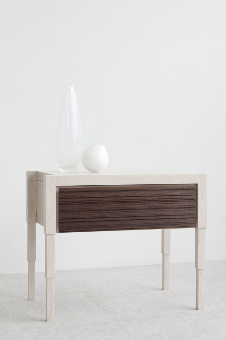 Careful consideration to detail is the acme to the design of this architecturally inspired side table or nightstand. Each table is fabricated by hand and available to order in 8 solid or combination traditional wood finish options.   Design features