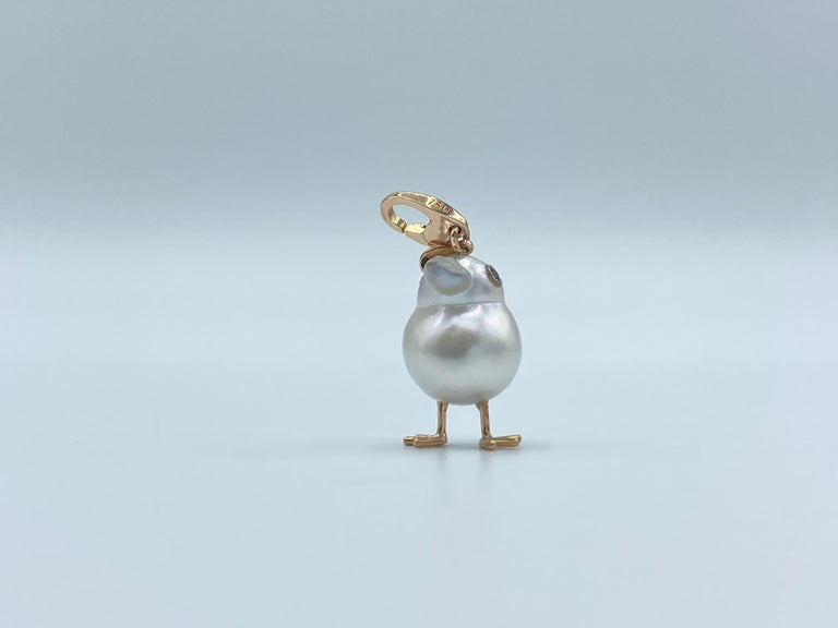 Chick Australian Pearl White Diamond 18Kt Red Gold Pendant Necklace or Charm  A beautiful yellow Australian pearl has been carefully crafted to make a chick. He has his two legs, two eyes encrusted with two black diamonds. I didn't have to add the