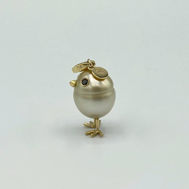 Chick Gold Pearl White Diamond 18Kt Gold Pendant Necklace or Charm  A beautiful yellow Australian pearl has been carefully crafted to make a chick. He has his two legs, two eyes encrusted with two black diamonds and his beak. The ring for the