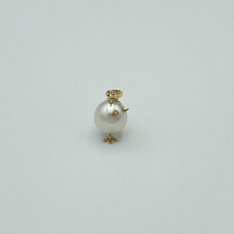 Chick Pearl Black Diamond 18Kt Gold Pendant Necklace or Charm Made in Italy An oval rare Australian pearl has been carefully crafted to make a chick. He has his two legs, two eyes encrusted with two brown diamonds and his golden beak.  The ring for