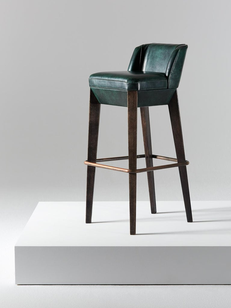 And Objects, product design studio founded by Martin Brudnizki and Nick Jeanes based in London.  Crafted from solid oak and featuring saddle-stitched leather detailing, the Chilcomb bar stool is a contemporary take on a traditional design. A
