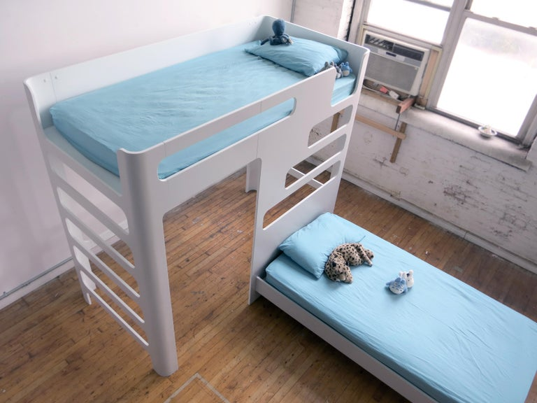 This is a kids' bunk bed. Ships flat and easily assembles with a simple cam and bolt fasteners. Pictured here are two full size mattresses. Main unit is lofted at 5 feet deck. Configuration, color, heights and mattress size can all be customized
