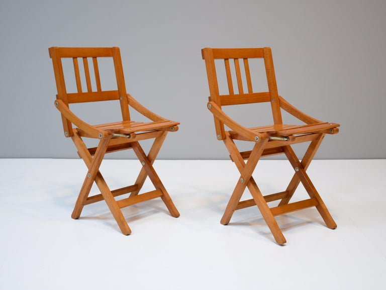 Amazing childrens foldable chairs made in Italy by Brevetti Reguitti, 1950s. This model looks very good to be up hanged on the wall when not used.