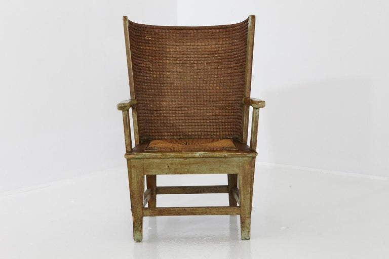 Late 19th-century child's armchair or fauteuil from the Scottish Orkney Islands, also referred to as Orkney Chair. The Orkney chair features an oak frame supporting a demicircle back in the style of wingback chairs, handwoven with straw.  The wooden