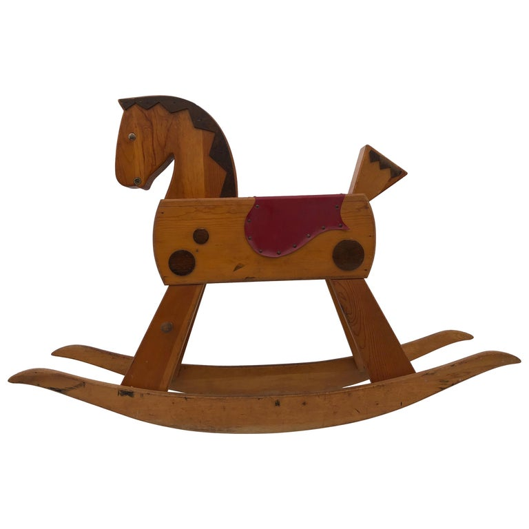 child s wooden rocking horse with footrest black wood mane and red