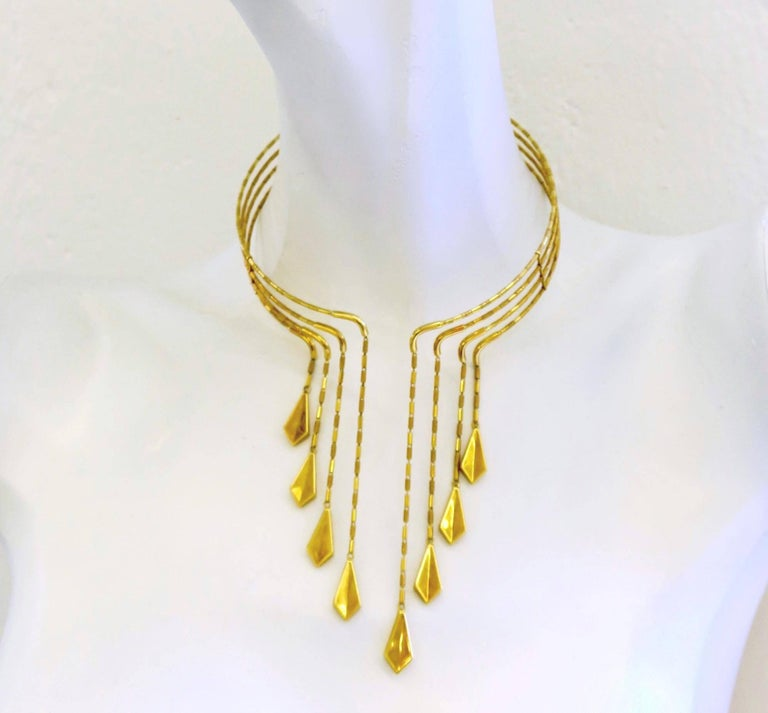 Collar necklace with articulated drops by Chimento. The 18k yellow four row gold necklace with eight graduated diamond shaped elements. Created in the 90's by Italian Jewelry firm Chimento, this piece seriously rocks. Lightweight enough to feel