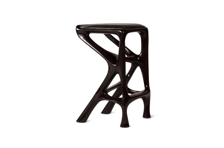 Barstool designed by Amorph made out of solid ashwood and leather. Stain color: Rusted walnut Dimension 27