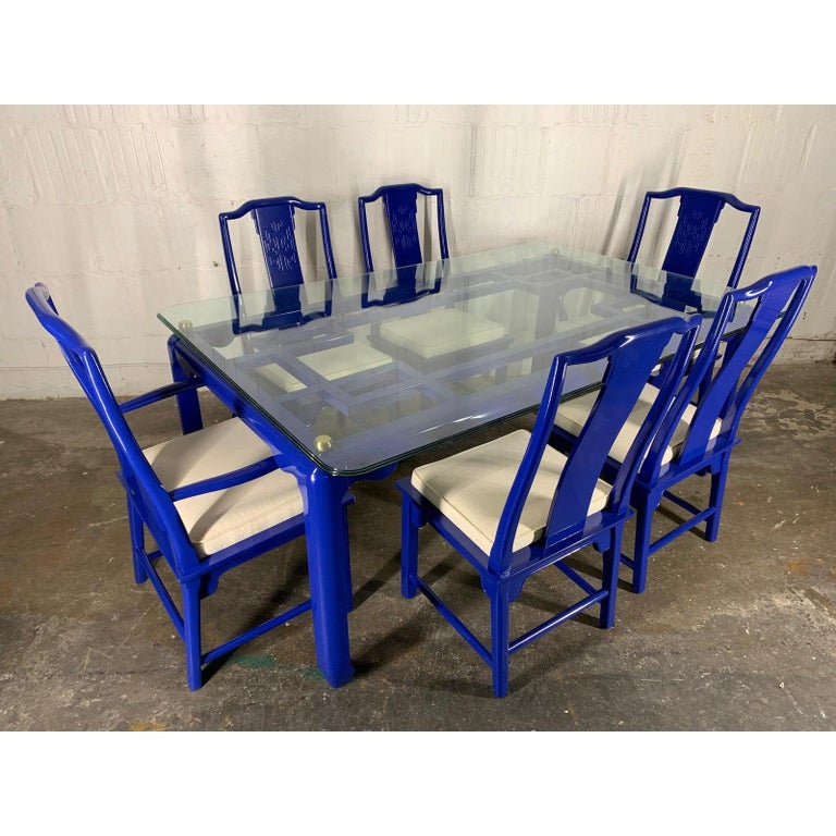 7-piece dining set by Century Furniture. Part of the Chin Hua collection by Raymond Sabota. Asian chinoiserie style newly lacquered in high gloss blue. Original seat upholstery has some slight discolorations. Glass top measures 72